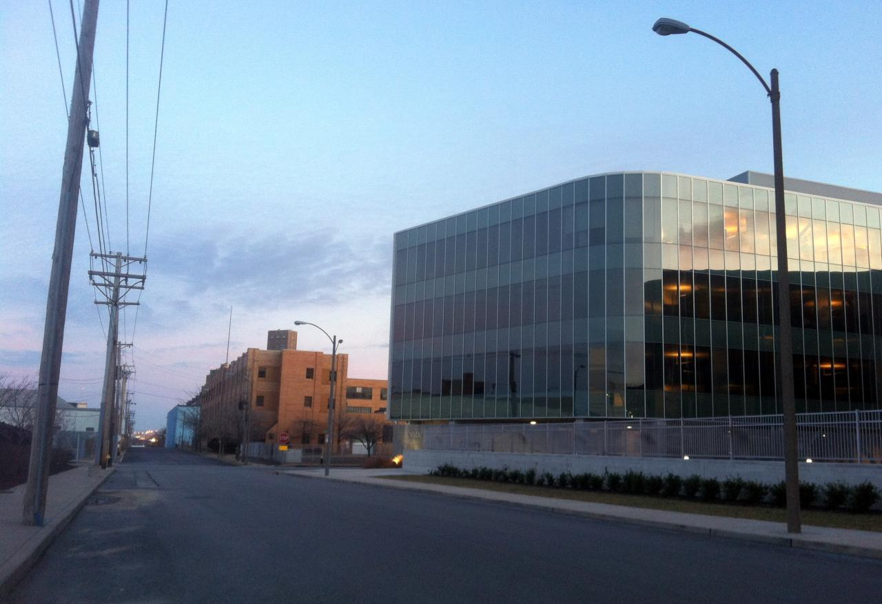 the sculpted modern glass Solae will continue to sit next to the Southwestern Bell building