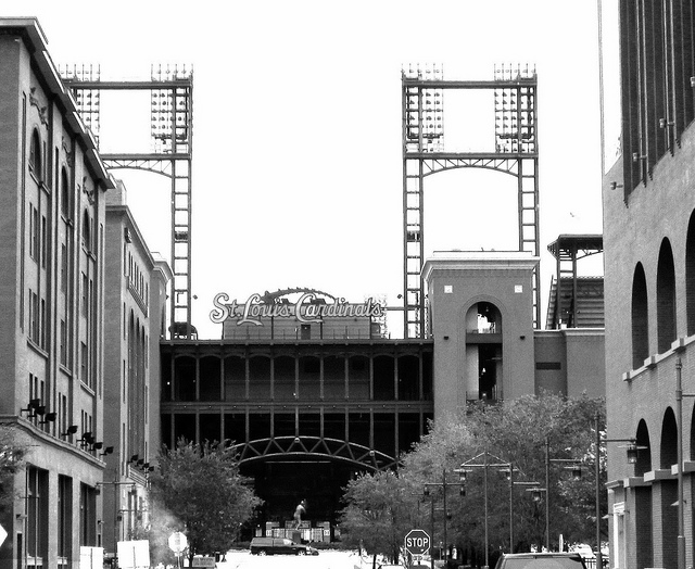 view looking east down Spruce Street framed by Cupples warehouses and Busch Stadium
